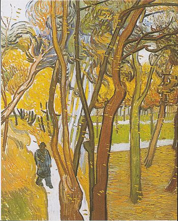 Walkers in the park with falling leaves